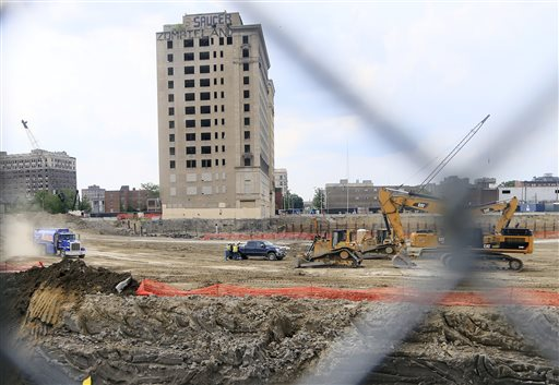 In this June 9, 2015, photo, construction crews work on the site of the new Detroit Red Wings arena in Detroit. Expanding the Republican Party's battle with organized labor, several GOP-dominated legislatures in the Midwest are moving to scrap labor laws that help unions win contracts on public works projects, an important source of construction jobs. (AP Photo/Carlos Osorio)