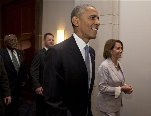 President Barack Obama, House Minority Leader Nancy Pelosi of Calif. and House Minority Assistant Leader James Clyburn of S.C., leave meeting with House Democrats on Capitol Hill in Washington, Friday, June 12, 2015. The president made an 11th-hour appeal to dubious Democrats on Friday in a tense run-up to a House showdown on legislation to strengthen his hand in global trade talks (AP Photo/Carolyn Kaster)