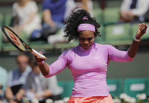 Serena Williams of the U.S. reacts as she plays compatriot Sloane Stephens during their fourth round match of the French Open tennis tournament at the Roland Garros stadium, Monday, June 1, 2015 in Paris. (AP Photo/Christophe Ena)