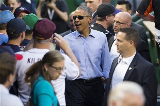 President Barack Obama walks in the Democratic dugout as he makes a visit to the Congressional baseball game at Nationals Park, on Thursday, June 11, 2015, in Washington (AP Photo/Evan Vucci)