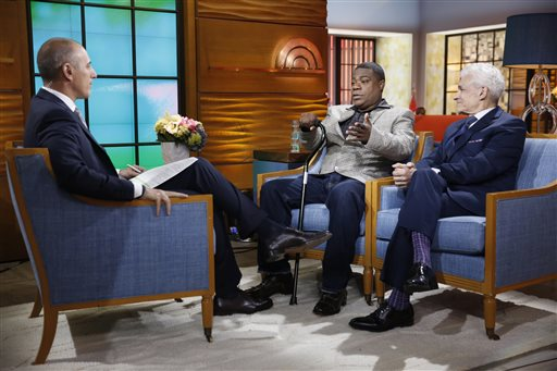 "This photo provided by NBC shows, from left, Matt Lauer, Tracy Morgan, and Benedict Morelli appearing on NBC News' ""Today"" show on Monday, June 1, 2015 , in New York. The actor-comedian Morgan said Monday he doesn't remember anything about the limo accident that left him in a coma for two weeks, and said that, a year later, he still has bad days as well as good. Appearing live on the ""Today"" show for his first public appearance since the accident, Morgan sat clutching a cane and became emotional as he recalled learning after the crash June 7, 2014, that his fellow comedian, James ""Jimmy Mack"" McNair, was killed. (Peter Kramer/NBC via AP)"