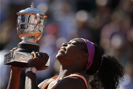 Serena Williams of the U.S holds the cup after defeating Lucie Safarova of the Czech Republic  during their final match of the French Open tennis tournament at the Roland Garros stadium,  Saturday, June 6, 2015 in Paris. Williams won 6-3, 6-7, 6-2.  (AP Photo/Francois Mori)