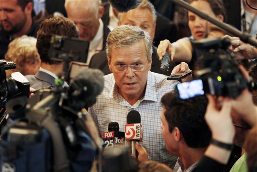 Republican presidential candidate, former Florida Gov. Jeb Bush talks to members of the media after speaking to voters at the Derry Opera House, Tuesday, June 16, 2015, in Derry, N.H. Bush is campaigning in the nation's earliest presidential primary state. (AP Photo/Jim Cole)