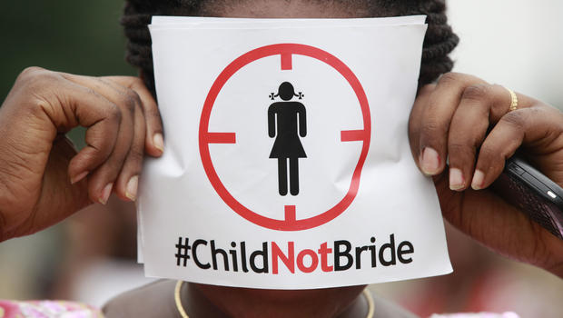 A woman protests against underage marriages in Lagos, Nigeria, July 20, 2013. (AP Photo)