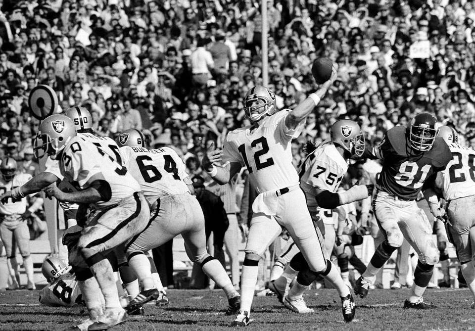ab1d2b3ff Quarterback Ken Stabler (12) of the Oakland Raiders gets off his pass  behind perfect