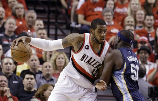 In this Monday, April 27, 2015 file photo, Portland Trail Blazers forward LaMarcus Aldridge, left, works the ball in against Memphis Grizzlies forward Zach Randolph during the first half of Game 4 of a first-round NBA basketball playoff series in Portland, Ore. A person with knowledge of the negotiations says LaMarcus Aldridge and the Miami Heat have spoken about his future plans, and that a formal conversation is scheduled for Thursday night, July 2, 2015. (AP Photo/Don Ryan, File)