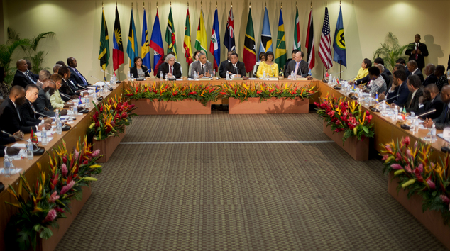President Barack Obama, center, speaks at the summit with Caribbean Community (CARICOM) leaders, Thursday, April 9, 2015, in Kingston, Jamaica. The president said Thursday that he soon decide whether to remove Cuba from the U.S. list of state sponsors of terrorism now that the State Department has finished a review on the question as part of the move to reopen diplomatic relations with the island nation.(AP Photo/Pablo Martinez Monsivais)