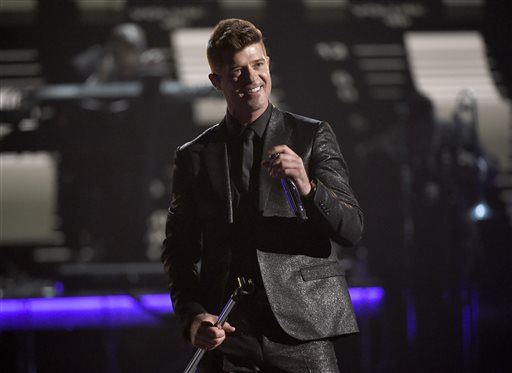 "In this Sunday, June 28, 2015 file photo, Robin Thicke performs during a tribute to Smokey Robinson at the BET Awards at the Microsoft Theater in Los Angeles. A federal judge in Los Angeles on Tuesday, July 14, 2015, trimmed a copyright infringement verdict against Thicke and Pharrell Williams over their 2013 hit ""Blurred Lines"" from nearly $7.4 million to $5.3 million. The ruling also gives Marvin Gaye's family, which sued the singers over the song, an ongoing shared of royalties from ""Blurred Lines.""  (Photo by Chris Pizzello/Invision/AP, File)"