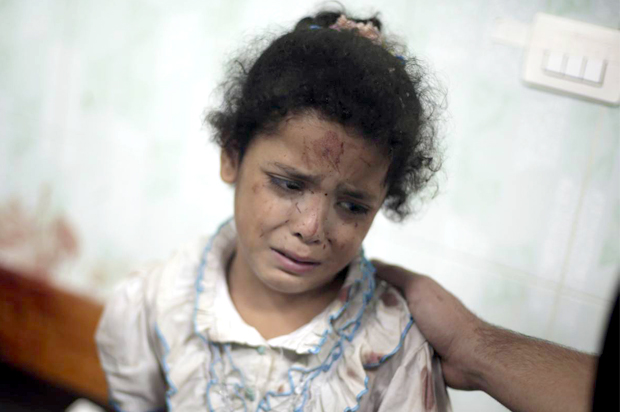 A Palestinian girl cries while receiving treatment for her injuries caused by a 2014 Israeli strike at a U.N. school in Jebaliya refugee camp, at the Kamal Adwan hospital in Beit Lahiya, northern Gaza Strip. (Khalil Hamra/AP Photo)