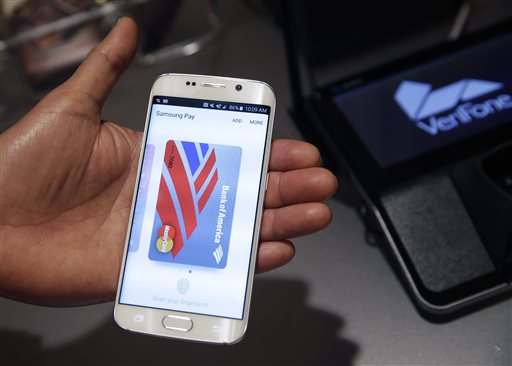 In this Aug. 6. 2015, photo, a Samsung employee demonstrates Samsung Pay using a Galaxy S6 Edge Plus in New York. (AP Photo/Seth Wenig)