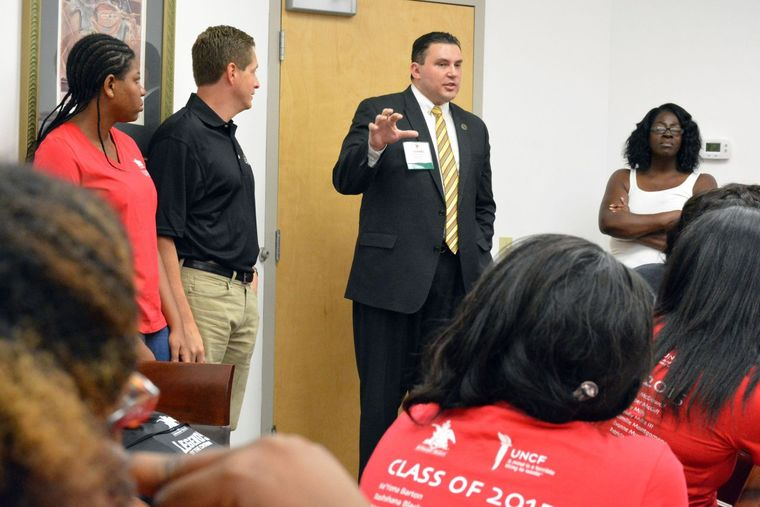 Michael McMillan, president and CEO of the Urban League of Metropolitan St. Louis, spoke to Legends of the Crown scholars on July 25 during their visit to the Urban League's Jennings Center. (Wiley Price/St. Louis American)