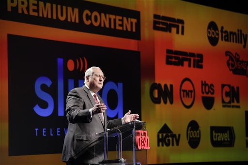 In this Jan. 5, 2015 file photo, Joe Clayton, president and CEO of Dish Network, introduces the Sling TV, a live television streaming service, at a news conference at the International CES in Las Vegas. Dish said its satellite TV subscriber losses accelerated in the quarter through June, falling 81,000 to 13.9 million, nearly double the loss of 44,000 a year ago. Analysts say that popular channels like ESPN would likely survive any dramatic shift in consumer preference toward online channel packages like Sling TV, which at $20 a month, is far cheaper than traditional pay TV packages. (AP Photo/Jae C. Hong, File)