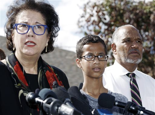 Ahmed Mohamed, 14, center, and his father Mohamed Elhassan Mohamed, right, look on as their attorney Linda Moreno, left, delivers a statement about the arrest of Ahmed during a news conference, Wednesday, September 16, 2015, in Irving, Texas. Ahmed was arrested after a teacher thought a homemade clock he built was a bomb. (AP Photo/Brandon Wade)