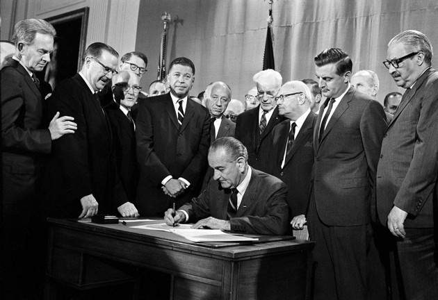 President Lyndon B. Johnson signs the Fair Housing Act into law in 1968. (AP Photo)