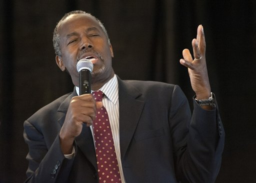 In this Sept. 11, 2015 file photo, Republican presidential candidate Ben Carson speaks in St. Louis. Carson has moved into the top tier of the 2016 presidential race as quietly as Donald Trump crashed the party with bombast, and he'll join the billionaire real-estate mogul as a focus of attention at the GOP's second debate. (AP Photo/Sid Hastings, File)