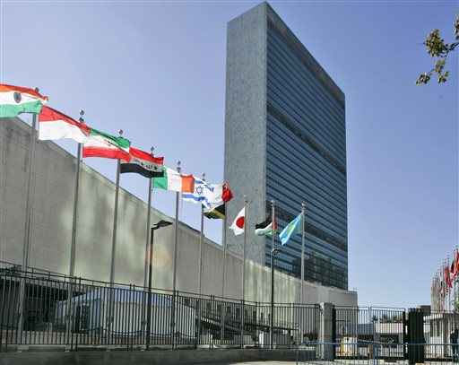 In this Sept. 18, 2007, file photo, the flags of member nations fly outside of the United Nations headquarters in New York. The U.N. General Assembly overwhelmingly approved a resolution Thursday, Sept. 10, 2015, allowing the Palestinians and the Holy See to raise their flags at U.N. headquarters — a symbolic step pursued by the Palestinians in their quest for an independent state. (AP Photo/Mary Altaffer, File)