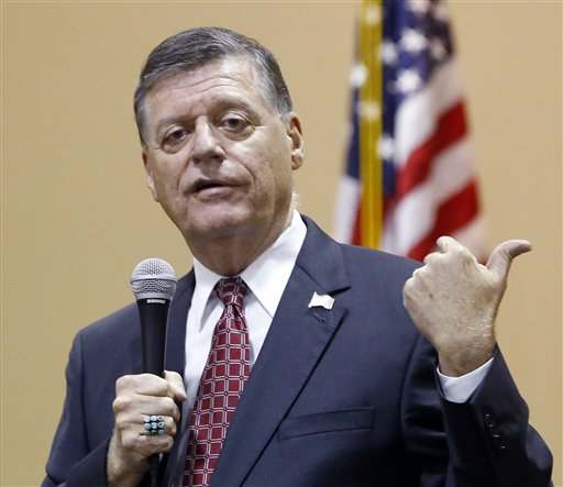 "In this Aug. 18, 2015, photo, Rep. Tom Cole, R-Okla., gestures as he speaks during a town hall meeting in Moore, Okla. Congress returns on Sept. 8 with a critical need for a characteristic that has been rare through a contentious spring and summer _ cooperation between Republicans and President Barack Obama. ""It's going to take a sense of give and take on both sides,"" said Cole. "":The big deal will be, 'Can you come to a deal on transportation, debt ceiling and avoiding sequester?' So a large budget deal will determine, I think, whether or not we've really been successful."" (AP Photo/Sue Ogrocki, File)"