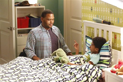 """In this image released by ABC, Anthony Anderson, left, and Miles Brown appear in a scene from the family comedy """"Black-ish."""" On the episode titled, """"The Word,"""" airing Wednesday, Sept. 23, Jack, portrayed by Brown, performs a song at a school talent show with a controversial lyric that leads to his possible expulsion from school. (Kelsey McNeal/ABC via AP)"""