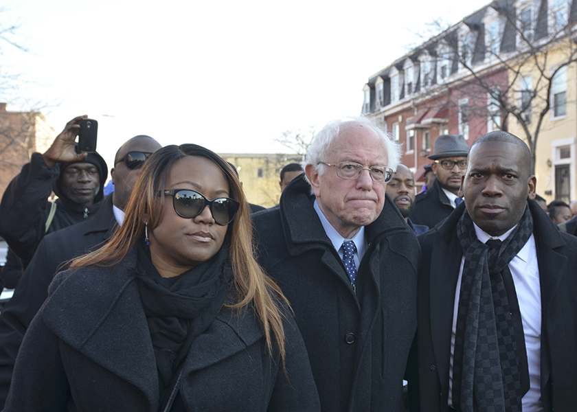 (Left to right) Lisa M. Weah, president of the Freddie Gray Community Association, Senator Bernie Sanders (D-Vt.), and Reverend Jamal Bryant, the pastor and founder of Empowerment Temple Church walk through the Sandtown-Winchester neighborhood in Baltimore, Md. (Freddie Allen/AMG/NNPA News Wire)