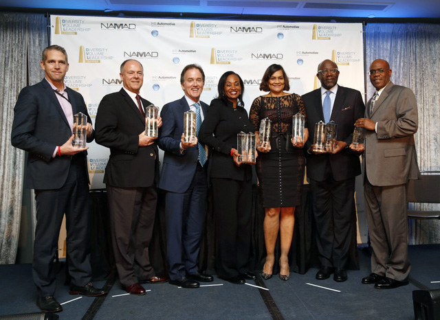 Toyota and Lexus team members hold the awards they won at the National Association of Minority Automobile Dealers and IHS Diversity Volume Leadership Awards at the Cobo Center in Detroit, Mich. on January 10, 2016. Left to right: Jeff Ball, Michael Rouse, Bill Fay, Alva Adams-Mason, Ayiko Broyard, Jim Colon and Glen Lee. (Jeff Kowalsky/TMS)