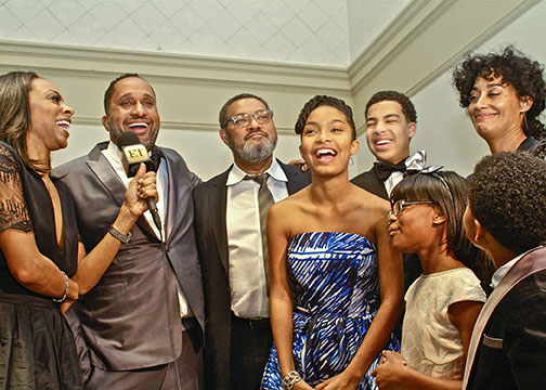"Entertainment Tonight's Nichelle Turner interviews the cast and producer of ABC'S ""black-ish."" Cast members (l-r) Laurence Fishburne, Marcus Scribner, Tracee Ellis Ross, Yara Shahidi, Marsai Martin and Miles Brown. (Mesiyah McGinnis/Los Angeles Sentinel)"
