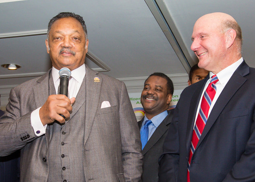 Rev. Jesse Jackson, Sr., (left) gives remarks during the 18th Annual Rainbow Push Wall Street Project Economic Summit as Steve Ballmer former CEO of Microsoft and owner of the Los Angeles Clippers looks on. (Rainbow PUSH Coalition)