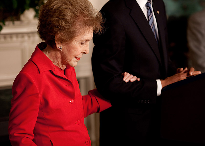 Former First Lady Nancy Reagan died Sunday at 94. This photo was taken as Nancy Reagan embraces President Barack Obama's arm at the podium as he announced and signed the Ronald Reagan Centennial Commission Act in the Diplomatic Room of the White House, June 2, 2009. (Pete Souza/The White House)