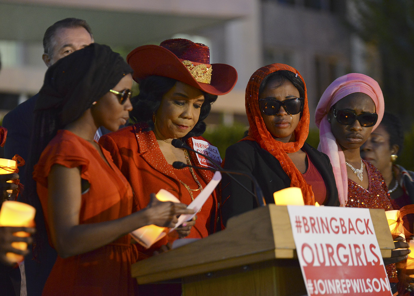 A Chibok school girl that escaped the Boko Haram kidnapping two years ago (left) reads from a list of names of the girls that are still missing as Rep. Frederica Wilson (D-Fla.) looks on during a candlelight vigil at the State Department in Washington, D.C. on April 20, 2016. (Freddie Allen/AMG/NNPA News Wire)