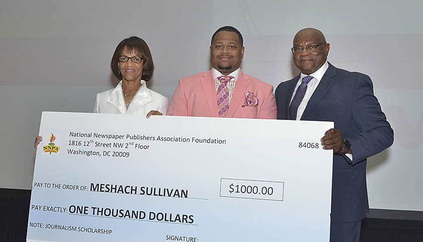 Meshach Sullivan (center), a student at Texas Southern University, received a $1,000 scholarship from the NNPA Foundation at the 2016 Merit Awards sponsored by Miller-Coors. Jackie Hampton (left), publisher of Mississippi Link and Al McFarlane, NNPA Foundation Chair joined Sullivan for the photo. (Freddie Allen/NNPA)