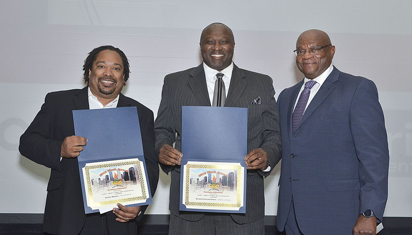 Chris Bennet (left), publisher of The Seattle Medium, and Jeffrey Boney (center), staff writer for the Houston Forward Times won 3rd place and 1st place, respectively for Best Column Writing at the 2016 NNPA Merit Awards ceremony in Houston, Texas. Al McFarlane, chairman of the NNPA Foundation, joined them in the photo. (Freddie Allen/NNPA)
