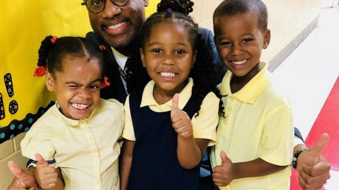 Principal LeVar Jenkins and kindergarten students and John Burroughs Elementary in Northeast, D.C. on the second.