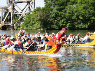 Two Dragon Boats racing in the Chicago River.