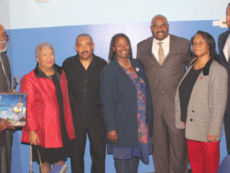 SUPPORTERS OF THE 2017 Annual Kings of Gospel concert congratulate Dr. Vernon G. Smith for a successful event, which included a record number of guests attending. The annual event was held in conjunction with the Gary Greats Awards Program. Pictured from l-r: John L. Smith, Dorothy R. Leavell, State Rep. Dr. Vernon G. Smith, Councilwoman Linda Barnes-Caldwell, Lake County Clerk Michael A. Brown, Ayanna Wright and State Rep. Earl Harris Jr. (Photos by Ted Brown)