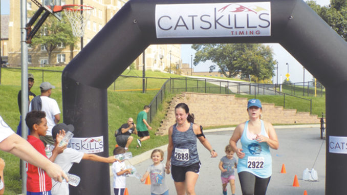 Runners cross a checkpoint during the Bishop Dunn Memorial School's Cupcake 5K Run/Walk on Sunday, September 16.