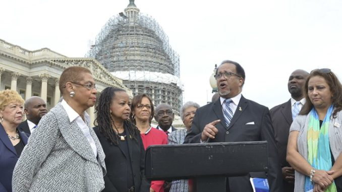 Congresswoman Eleanor Holmes Norton stands with NNPA President and CEO Dr. Benjamin F. Chavis Jr., and members of the Black and Hispanic press at a news conference on Capitol Hill in 2016/Washington Informer Photo