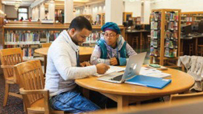 UWM education student Dianna Herron (right) works with Juan Emanuel Molina Morales.