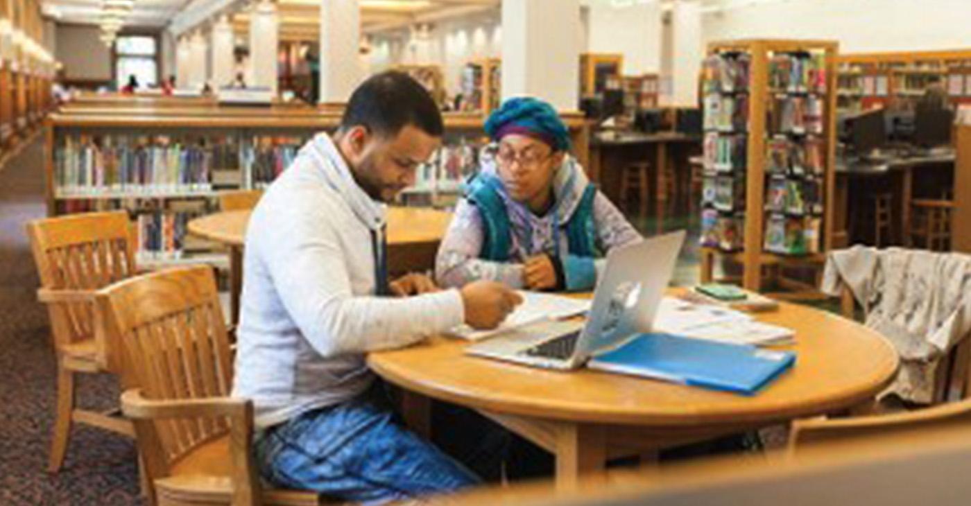 UWM education student Dianna Herron (right) works with Juan Emanuel Molina Morales.