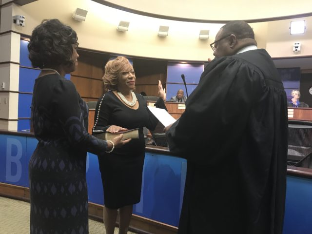 Wardine Alexander (center) is sworn in by Andra D. Sparks, presiding Municipal Court judge, as her sorority sister, Nanette Baldwin, president of Omicron Omega chapter of Alpha Kappa Alpha assists. (Erica Wright Photo, The Birmingham Times)