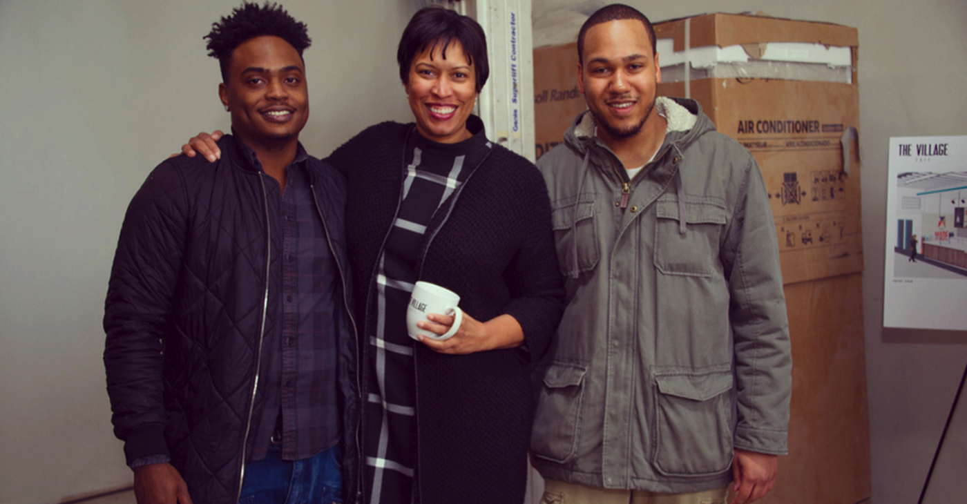 Mayor Muriel Bowser (center) enjoys a cup of coffee with Village Cafe co-founders Kevon King and Ryan Williams.