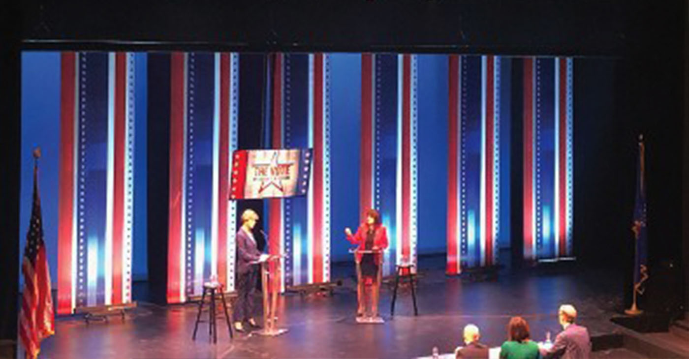 U.S. Senator Tammy Baldwin (right) and challenger Leah Vukmir (left) debate about a variety of issues. (Photo by Nyesha Stone)