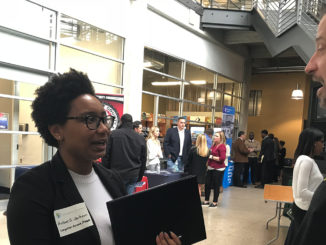 A student speaks with a representative from McLeod Software during the Code the Classic Career Tech Expo. (Erica Wright, The Birmingham Times)