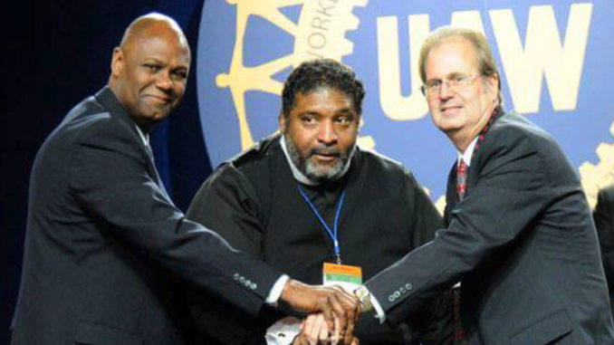 UAW Secretary-Treasurer Ray Curry, Reverend William Barber II, and UAW President Gary Jones stand in solidarity following Rev. Barber's speech on equality.