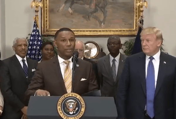 Johnny Taylor Jr., former president of the Thurgood Marshall College Fund, speaks during a Feb. 27 event at the White House to announce his appointment by President Donald Trump (right) as chair of the president's board of advisers for historically Black colleges and universities (HBCUs).