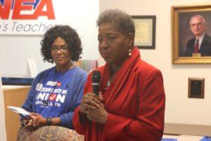 Brenda Gilmore talks to union members. Central Labor Council President Vonda MCDaniel listens.