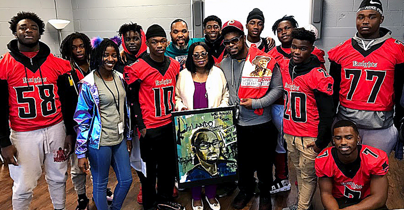 Members of the Majestic Knights football team asked to take a photo with Valerie Castile, center, mother of Philando Castile, her first born son who was killed in 2016 by police during a traffic stop. She gave them advice on ways to stay safe when confronted by the police. / Photo by DR Barnes.