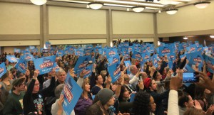 The crowd held Tammy Baldwin signs high in the air to show their support. (Photo by Nyesha Stone)