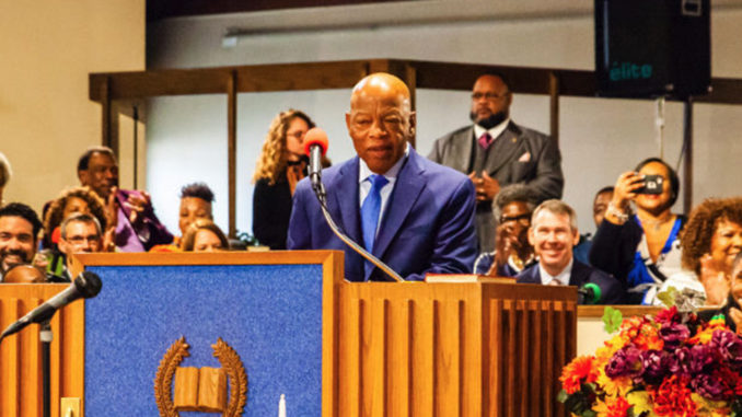 Civil Rights icon and Congressman John Lewis, (D-Georgia), speaks to Cincinnatians at Beloved Community Church in Avondale Sunday. At far left is Aftab Pureval, Democratic candidate for the U.S. House of Representatives in Ohio's District 1. Seated, in front, is the Rev. Nelson Pierce, pastor at Beloved Community. Photo by Carissa Smith
