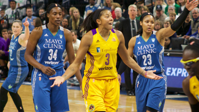 Candace Parker of the Los Angeles Sparks surrounded by the Minnesota Lynx