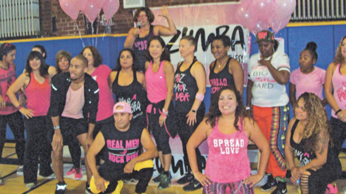"Some of the many area Zumba instructors who devoted their time and energies to Sunday's ""Party in Pink,"" Zumbathon held in honor of Breast Cancer Awareness Month."