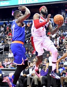 Washington Wizards point guard John Wall drives to the basket past New York Knicks guard Emmanuel Mudiay in the first quarter of the Knicks' 124-121 preseason win at Capital One Arena in D.C. on Oct. 1. (John De Freitas/The Washington Informer)